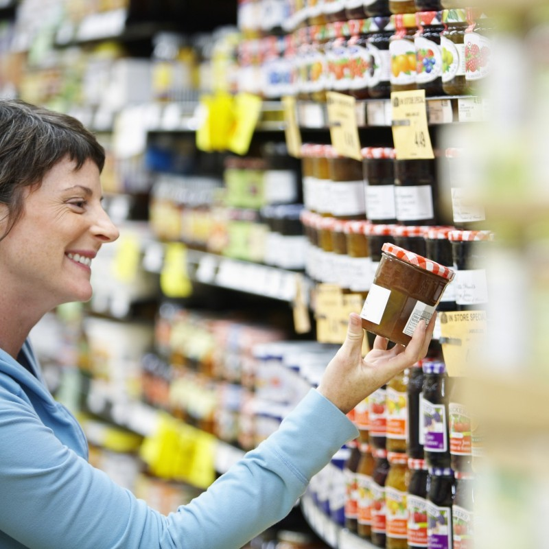 woman-looking-at-jam-commercial-labels